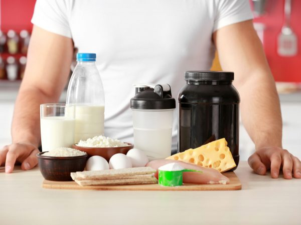 Man and healthy food in kitchen